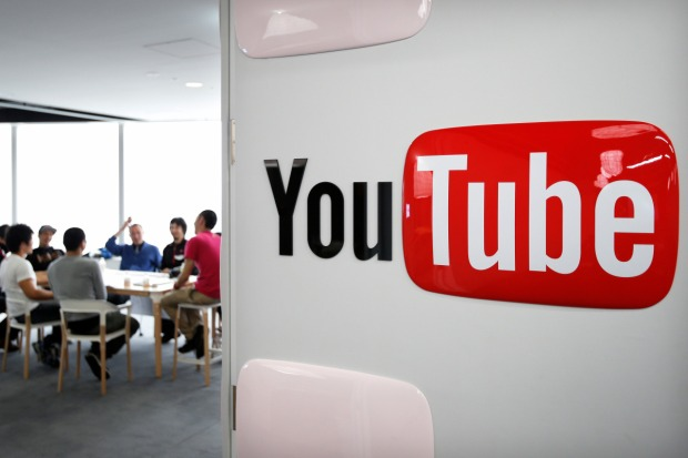 Google Inc.'s YouTube logo is displayed on a wall as video creators participate in a workshop as part of the YouTube Partner Program at the company's YouTube Space studio in Tokyo, Japan, on Saturday, March 30, 2013. In Japan, YouTube's biggest regional success story in Asia, the company is recruiting online stars to bolster its local-language channels with more-targeted original programming and higher production values. Photographer: Kiyoshi Ota/Bloomberg via Getty Images