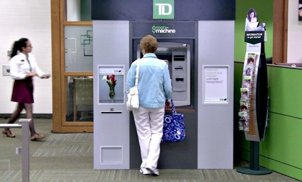 Ação de relacionamento do Banco TD Canadá Trust através de ATMs que agradeciam e presenteavam seus clientes